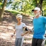Seniors being active, jogging a trail