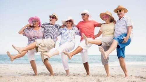 senior friends on the beach