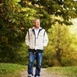 Senior taking walk to help boost immune system