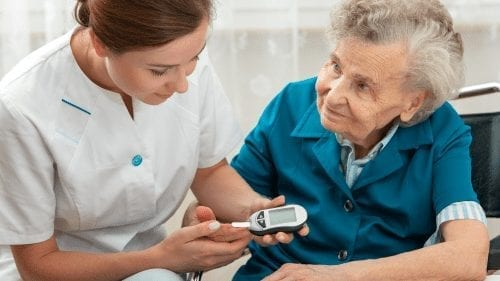 senior measuring blood glucose level diabetes