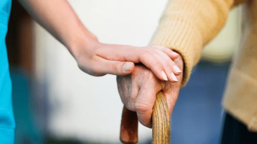 nursing-nurses hand holding hand
