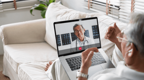 medical technology- Man on computer with doctor