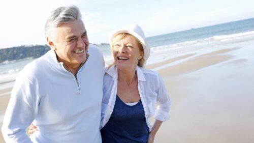 two seniors hugging on beach- heatstroke