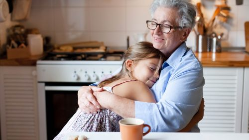 grandmother and granddaughter hugging acts of kindness