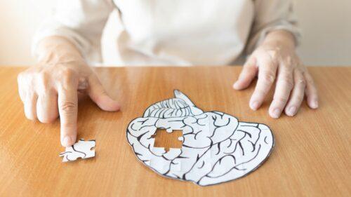 woman doing brain injury puzzle
